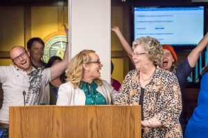 Harmony Harkrider, association president, reveals the celebration surprise to advisor Mary Kohls. 4/28/2017 Image Credit: Jessica Cargill
